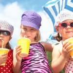 Cute children with soft drinks